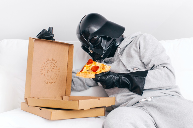 Darth Vader eating pizza