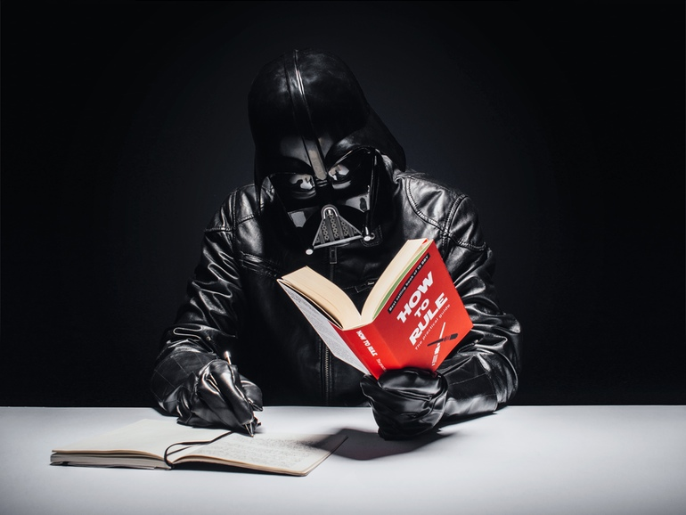 Darth Vader reading a book