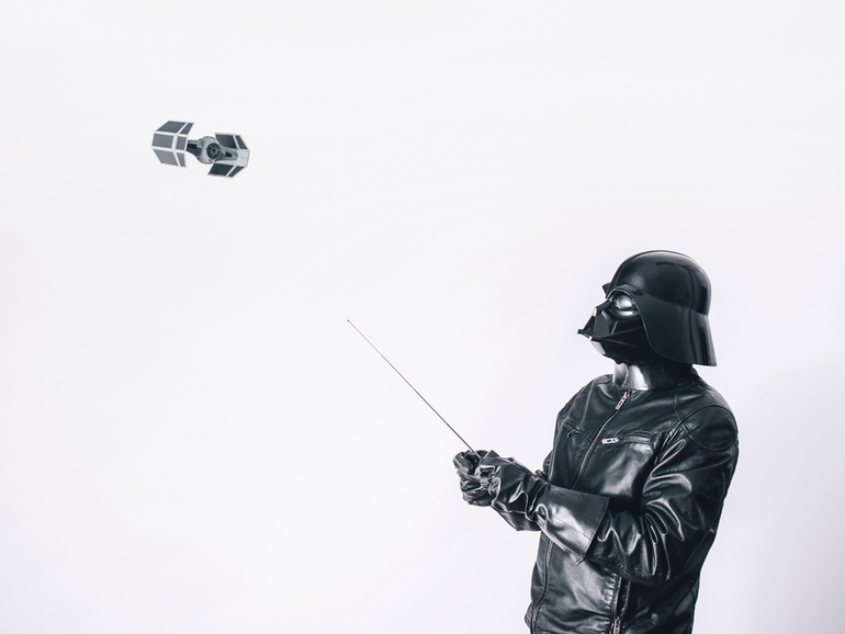 Darth Vader flying a remote controlled tie-fighter