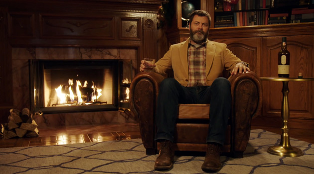 Here's 45 Minutes Of Nick Offerman Sipping Scotch Whisky By A Yule Log