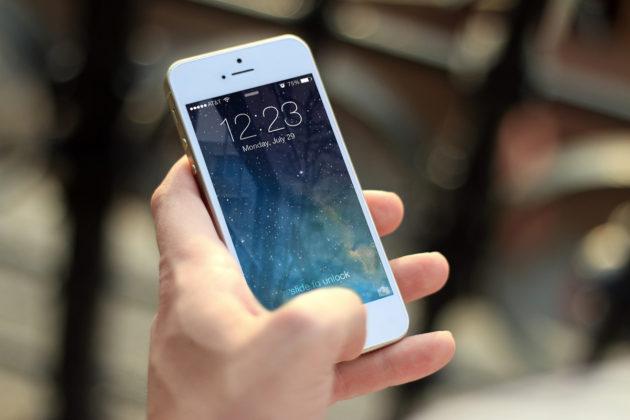 guy holding smartphone
