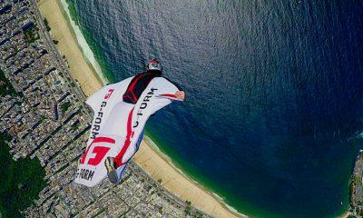 Jamie Flynn flys past Christ The Redeemer in a wingsuit