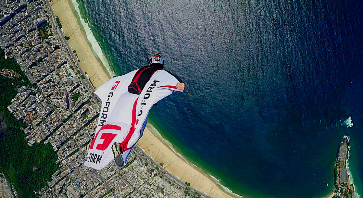 Jamie  Flynn flys past Christ The Redeemer in a wingsuit