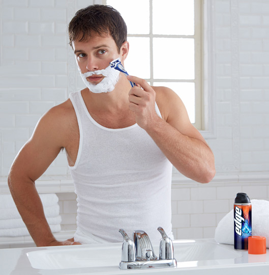 Man shaving with Edge Shave Gel and Schick Hydro 5