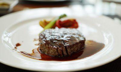 Eating a steak dinner