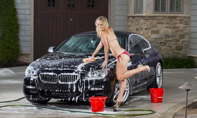 Girl in bikini giving a BMW a car wash