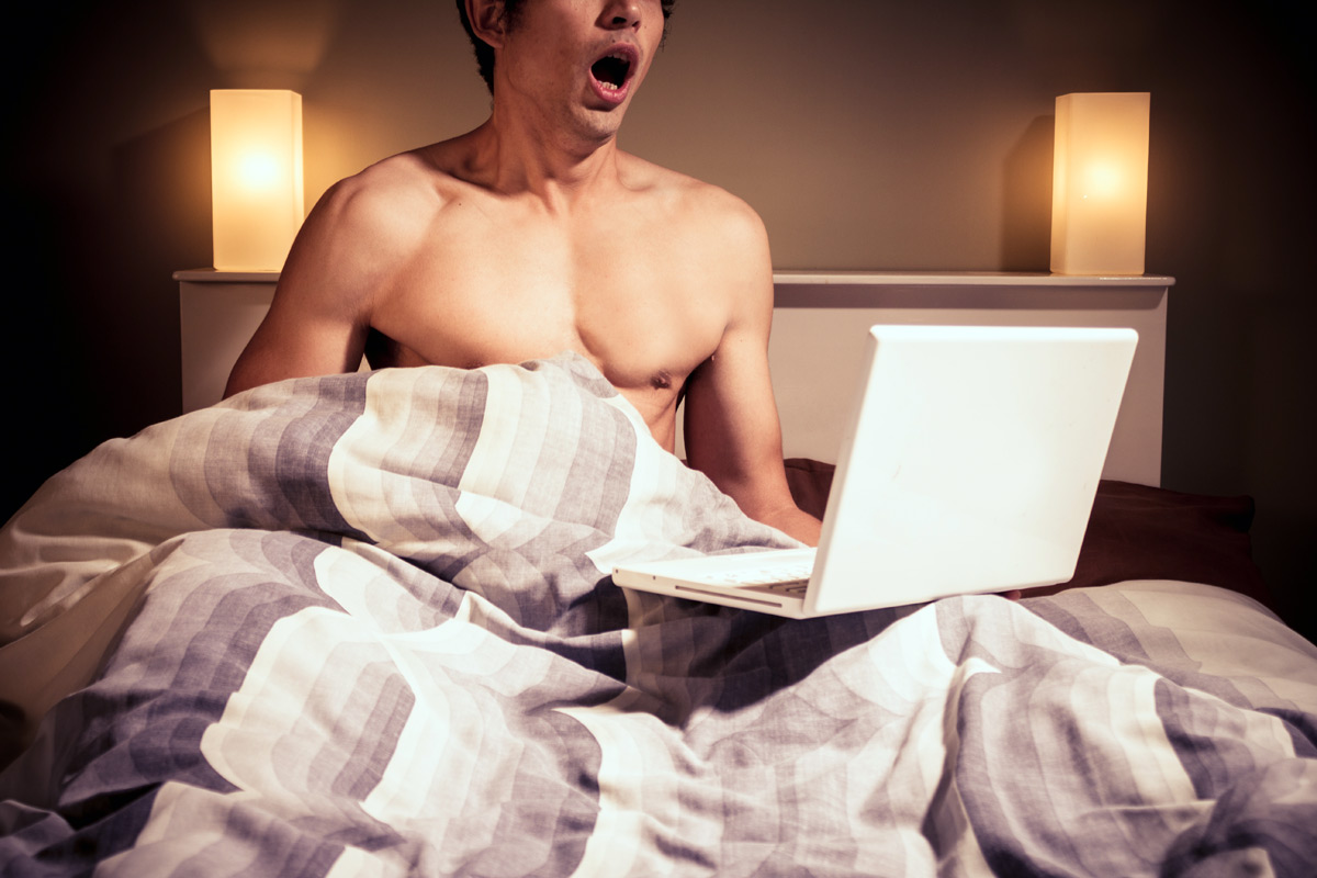 Guy In Bed Watching Porn