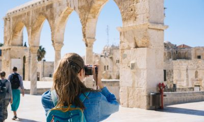 Woman taking pictures of ruins