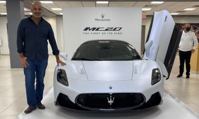 Sujeet Patel standing with the Maserati MC20
